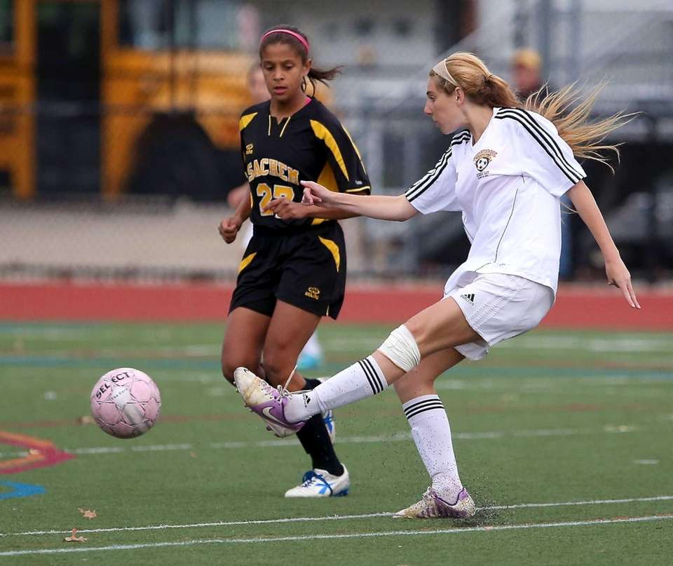 Commack's Jessica Silverman, right, puts the shot on