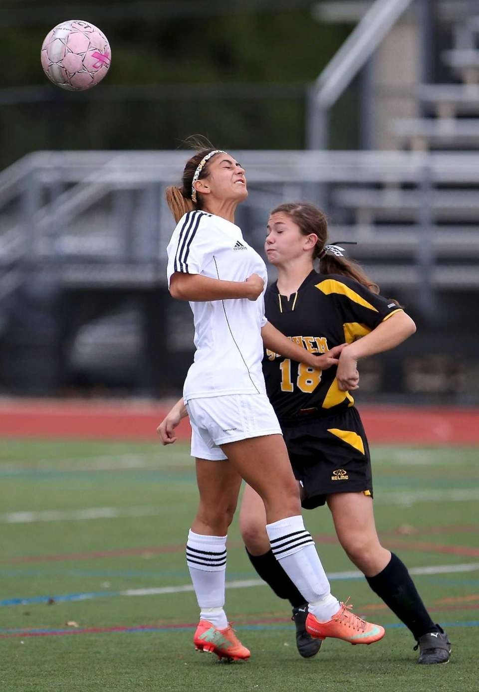 Commack's Julia Montella heads the ball away from