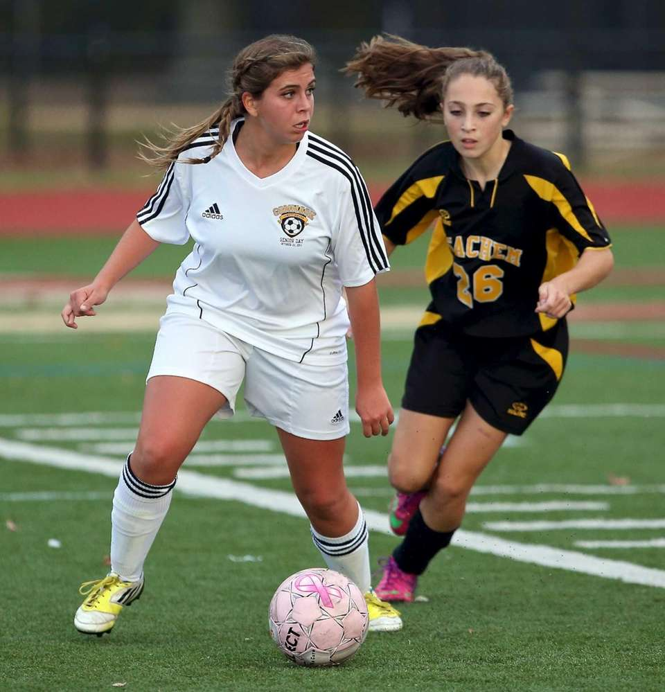Commack's Megan Janis looks to pass as Sachem
