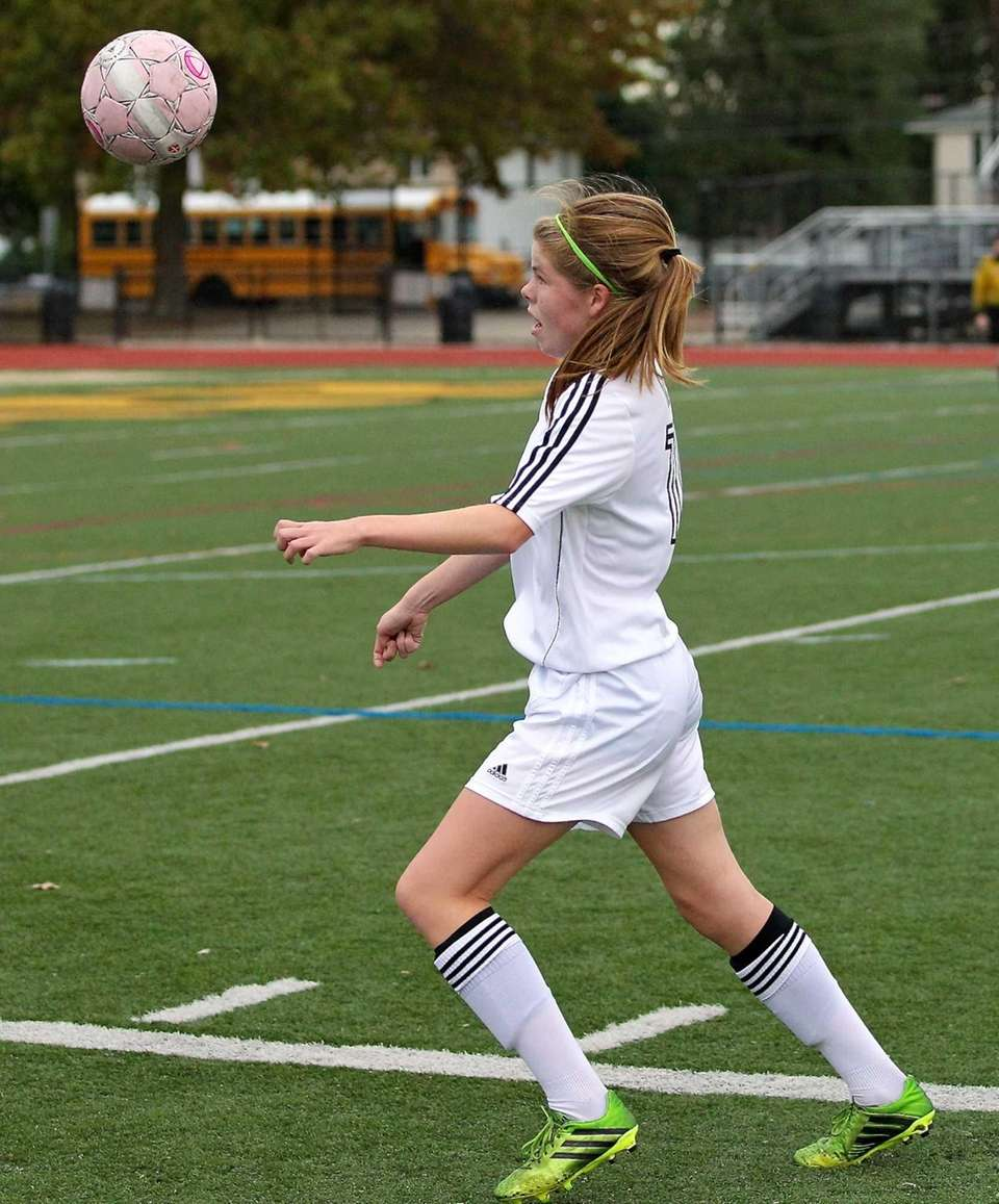 Commack's Erin Neville moves the ball forward in