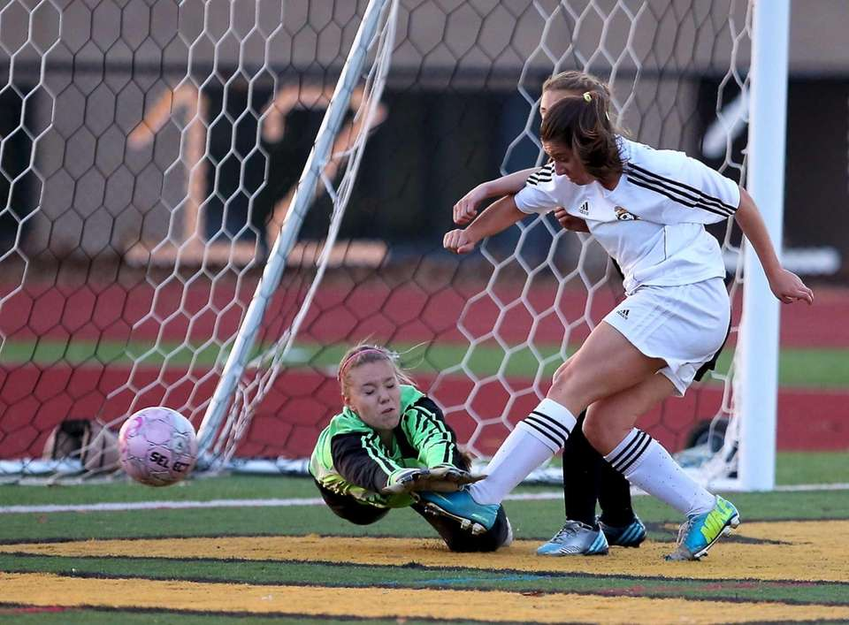 Commack's Mallory Dugan gets the shot off as