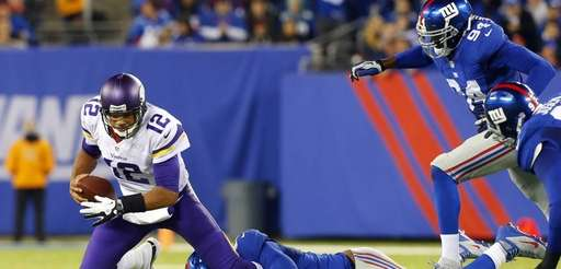 Minnesota Vikings quarterback Josh Freeman is sacked in