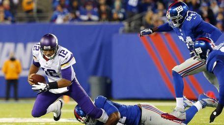 Minnesota Vikings quarterback Josh Freeman is sacked in