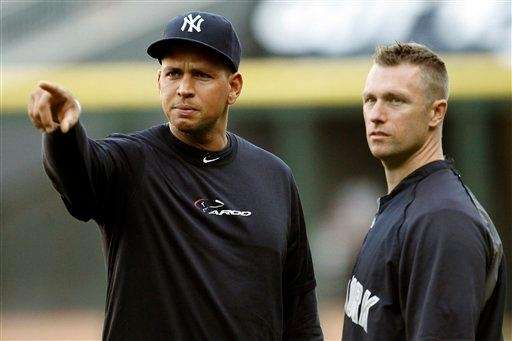 Alex Rodriguez, left, gestures alongside strength and conditioning