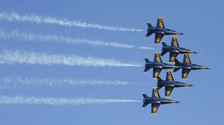 The Blue Angels practice near the stadium before