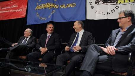 Nassau County Executive Edward Mangano, second from left,