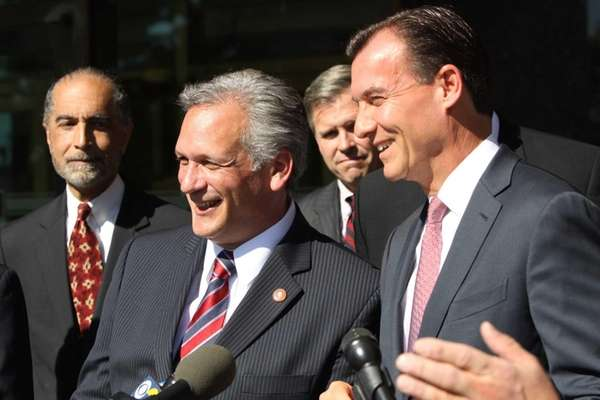 Nassau County Executive Edward Mangano, left, stands beside
