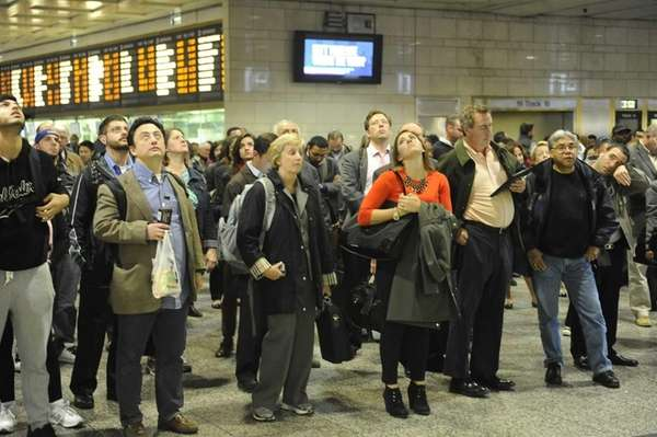 Long Island Rail Road commuters wait for trains