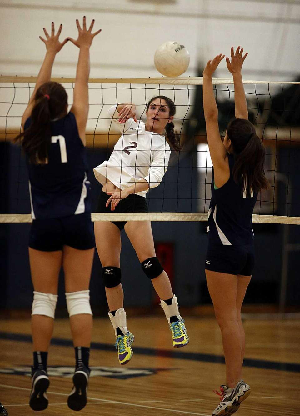 Kings Park's Joell Goldstein spikes the ball between