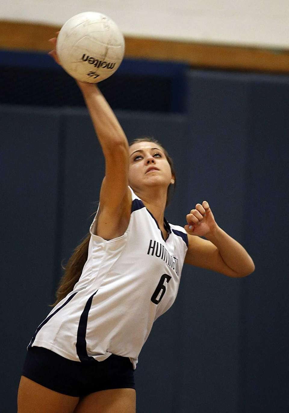 Kings Park's Jaclyn Wilton serves the ball in