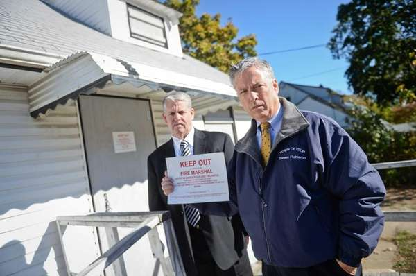 Islip Town Conuncilman Steven J. Flotteron, right, and