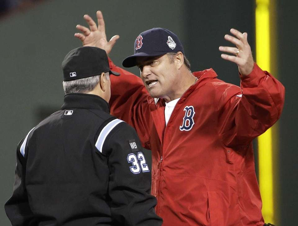 Boston Red Sox manager John Farrell argues a