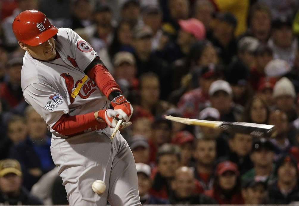 St. Louis Cardinals' Allen Craig breaks his bat
