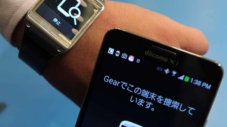 The Galaxy Gear watch, left, and Galaxy Note