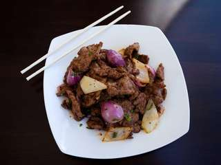 The cumin beef, velvety slices of steak thinly