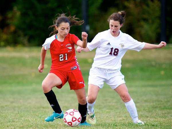 Long Island Lutheran forward Christina Loizou battles for