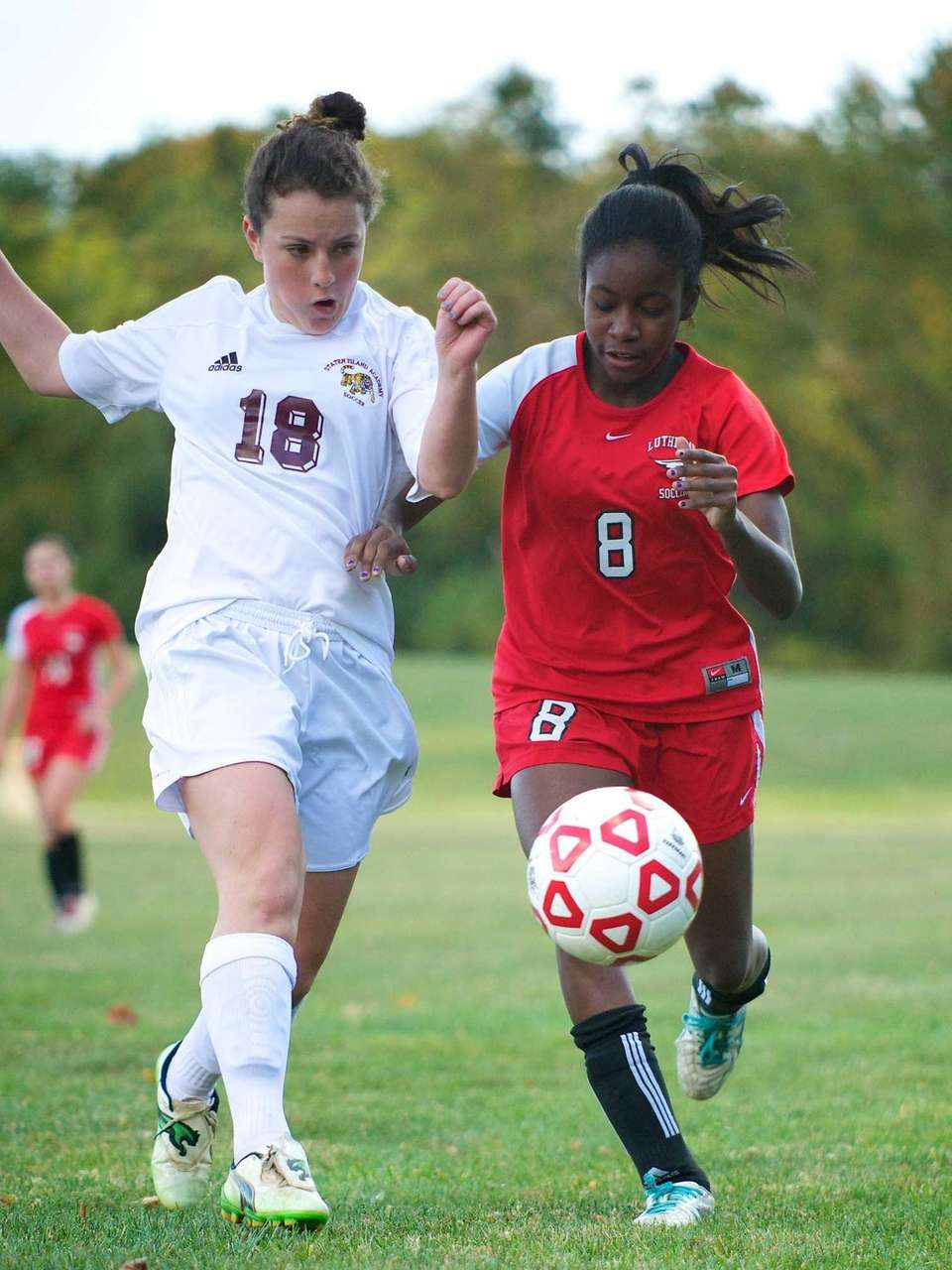 Long Island Lutheran forward Kennedy Kerr battles with