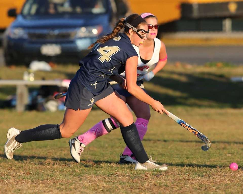 Shoreham-Wading River's Alexandra Hutchins moves the ball up