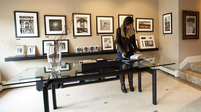 A customer browses through the B.Street LTD Gallery,
