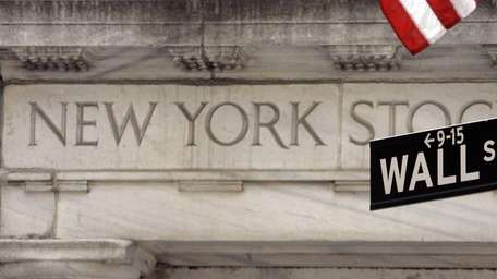A Wall Street sign is seen at an