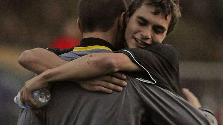 St. Anthony's goalie Josh Weiss, left, gets congratulated