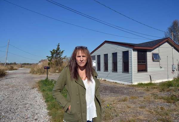 Shelley Murphy outside her Riviera Drive property in