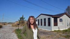 Shelley Murphy outside her Riviera Drive property in
