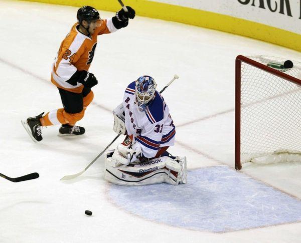 Philadelphia Flyers' Matt Read cheers after scoring a