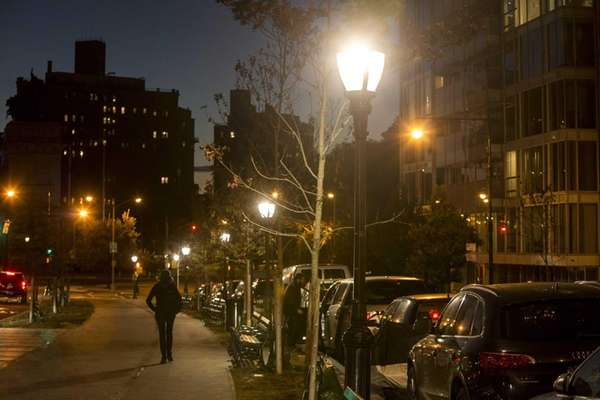 LED lamp posts illuminate the sidewalk along Eastern