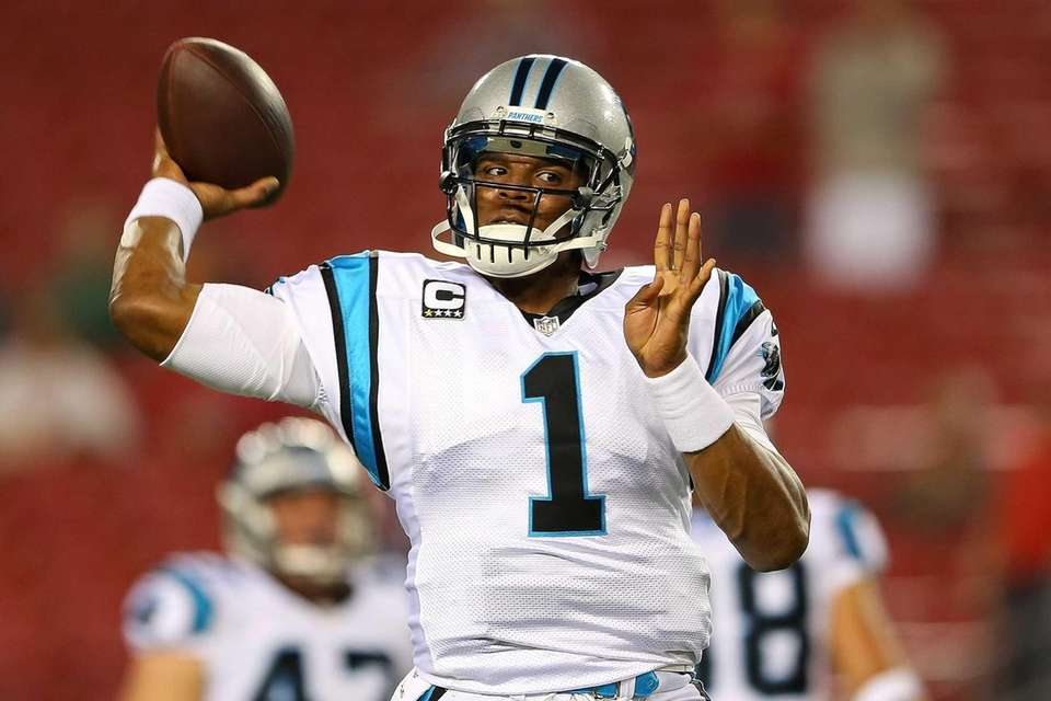 Cam Newton of the Carolina Panthers warms up