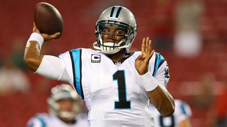 Cam Newton of the Carolina Panthers warms up