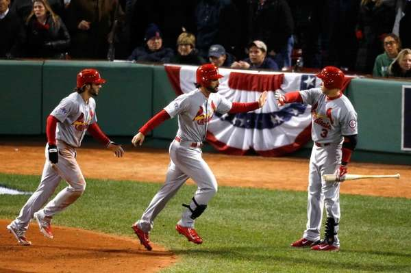 Matt Carpenter celebrates with Carlos Beltran and Pete
