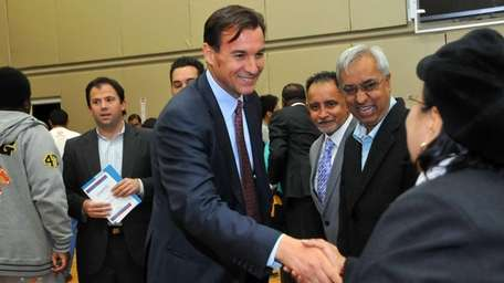 Tom Suozzi greets attendees at a bilingual candidates