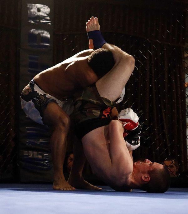 Dakota Giguere (bottom) holds off Victor Robinson in