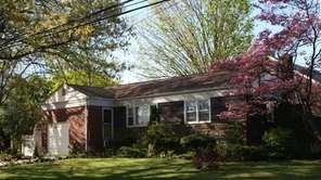 This three-bedroom, 1½-bathroom ranch is located in Malverne.