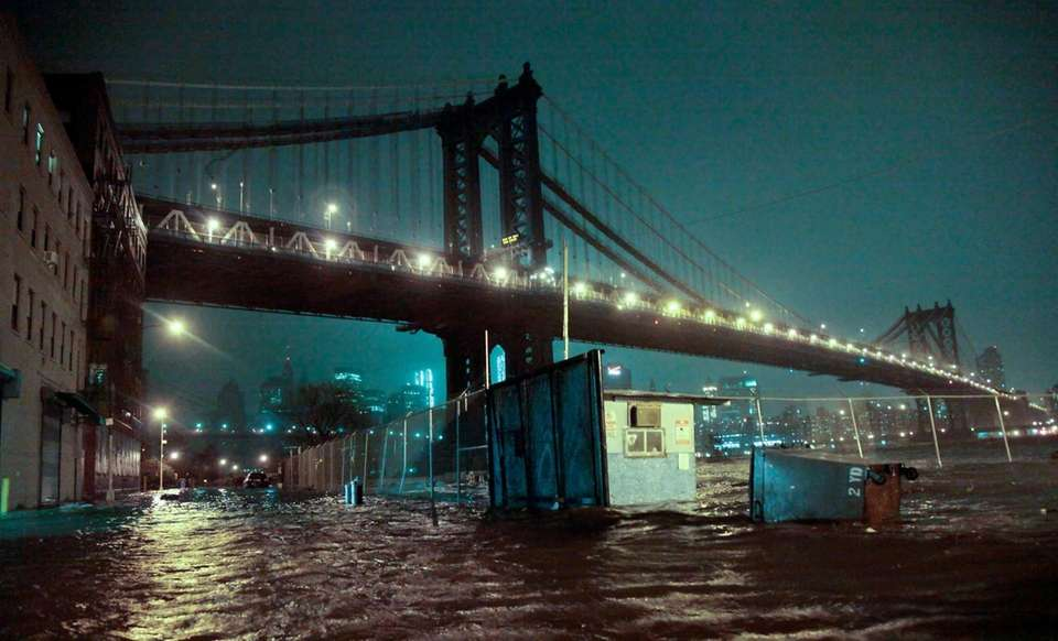 Flooded streets under the Manhattan Bridge in the