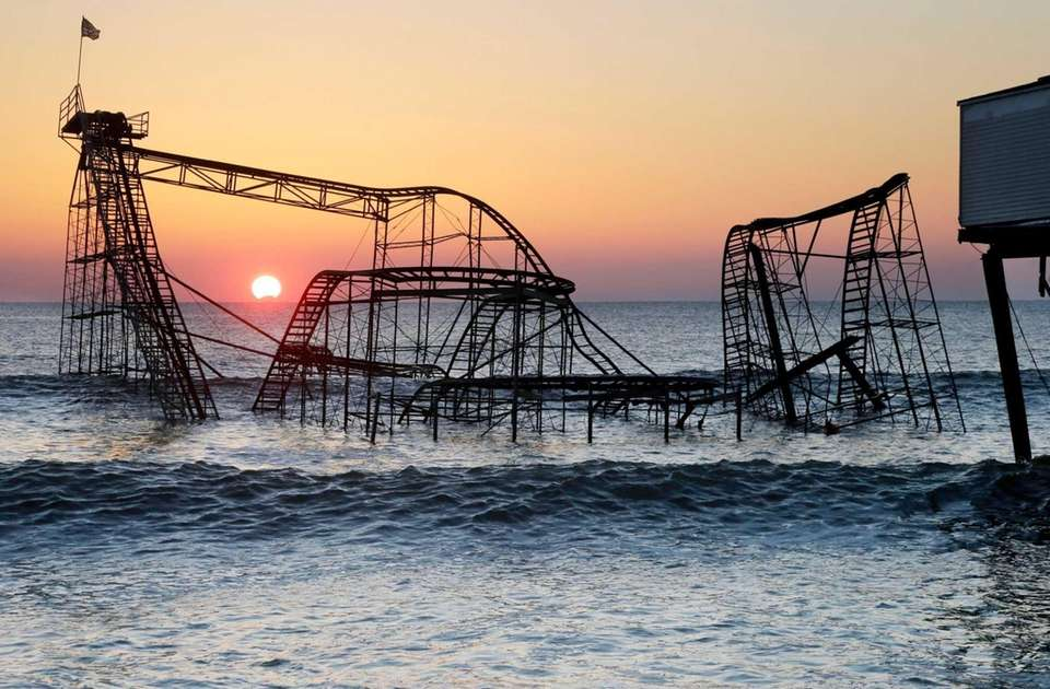 The sun rises in Seaside Heights, N.J., behind