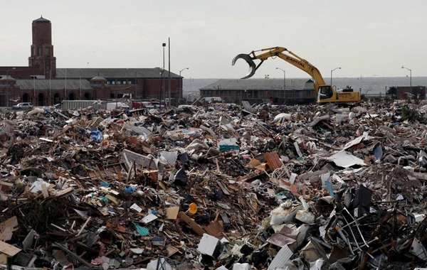 Construction equipment works on debris collection during the
