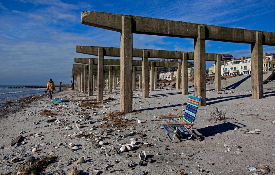 Rockaway resident Christine Walker strolls along the beach