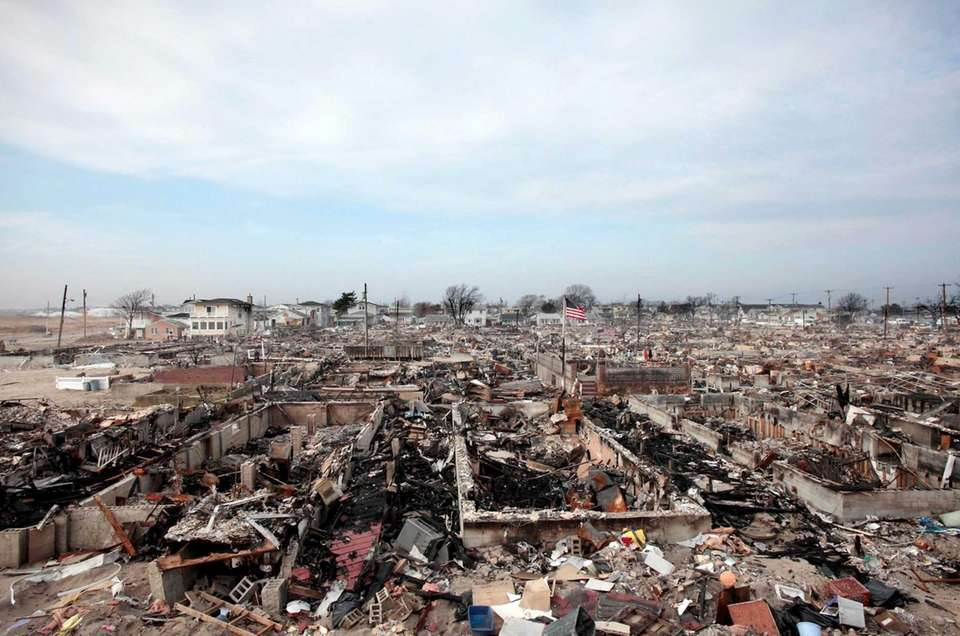 Ruins of more than 100 homes in the