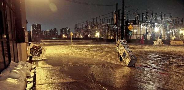 Flooded streets around a Con Edison power substation