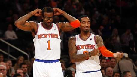 Amar'e Stoudemire #1 and J.R. Smith #8 of