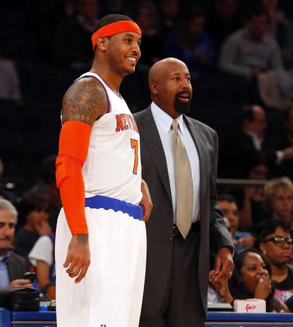 Carmelo Anthony and Mike Woodson look on during