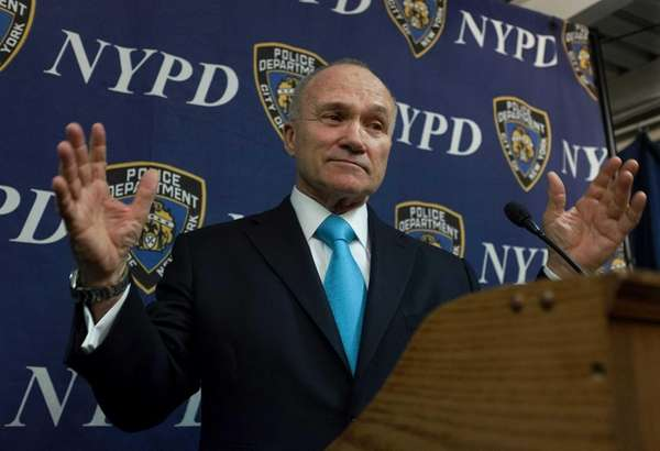 Police Commissioner Raymond W. Kelly shares a lighter