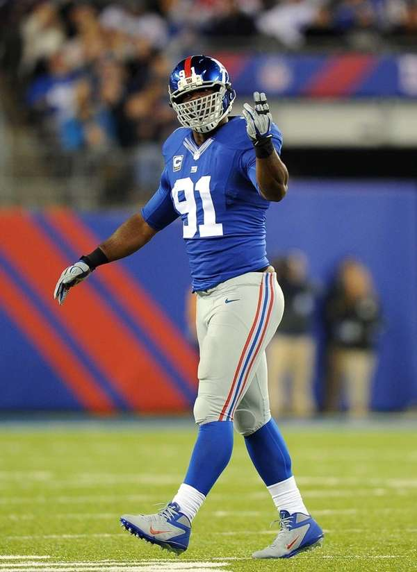 Defensive end Justin Tuck reacts after a defensive