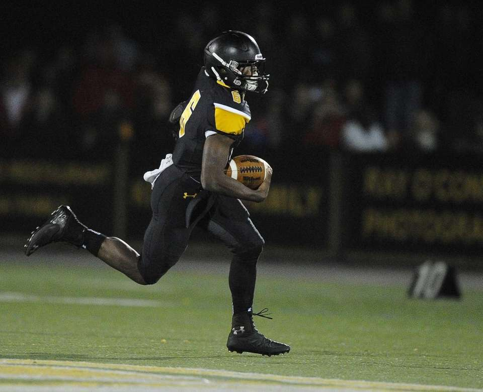 St. Anthony's running back Naim Jones rushes the