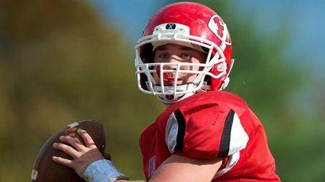 East Islip quarterback Jack Hannigan looks for an