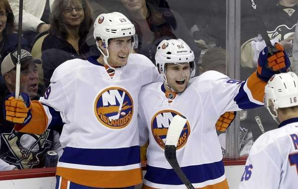 New York Islanders' Pierre-Marc Bouchard, right, celebrates his