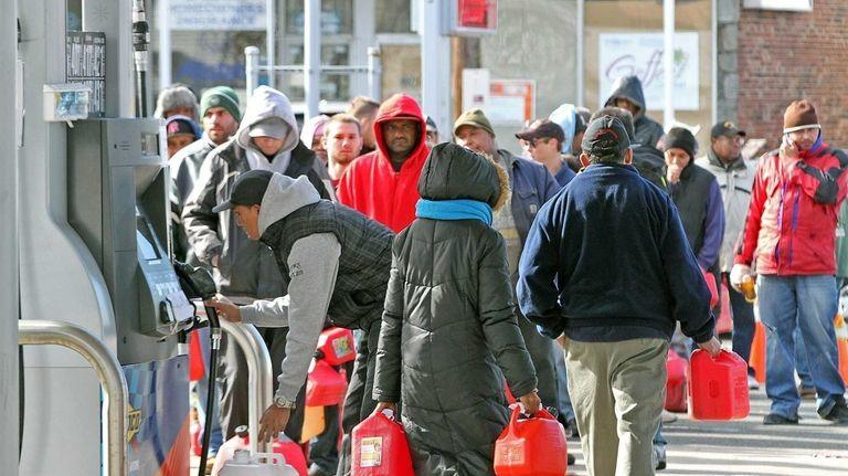 A week after superstorm Sandy, Long Islanders line