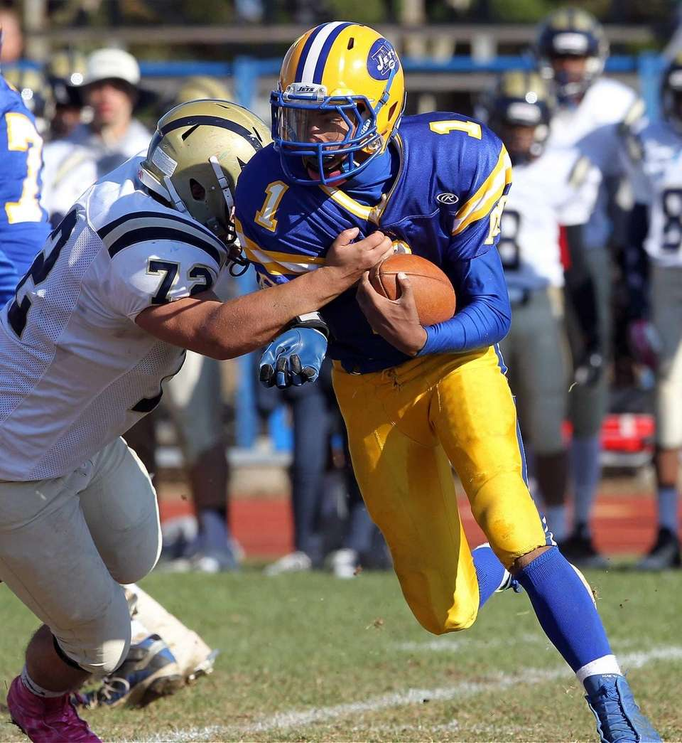 East Meadow's Anthony Love runs the ball on